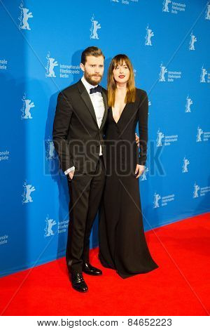 BERLIN, GERMANY - FEBRUARY 11: Actress Dakota Johnson, Jamie Dornan, 'Fifty Shades of Grey' premiere, 65th Berlinale International Film Festival at Zoo Palast on February 11, 2015 in Berlin, Germany.