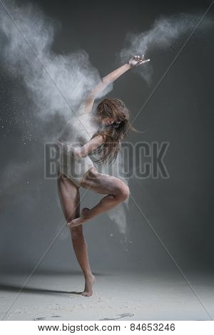 female dancer posing on studio background