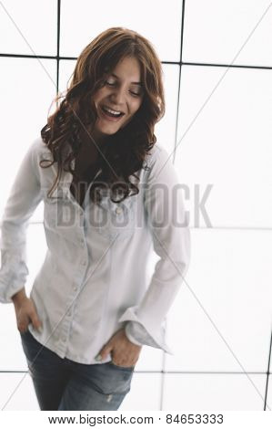 happy young woman ,natural light from window