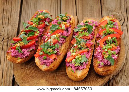 Vegetarian Sandwiches With Beetroot, Bell Pepper, Parsley And Scallion On Wooden Background