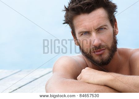 Handsome Man With No Shirt Posing At The Sea