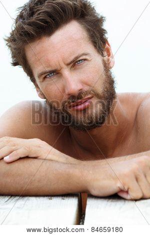 Portrait Of Confident Seductive Handsome Man