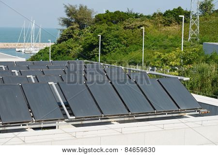 Solar water heating panel on a house roof