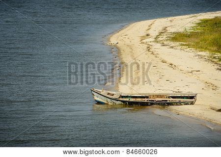 Abandoned oyster boat on beach