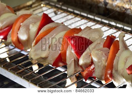 meat grilled on barbecue  with peppers