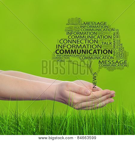 Conceptual tree word cloud tagcloud, man or woman hand on green blur grass background, metaphor to communication speech, message, mail, dialog, talk, contact, email, connection, news or internet