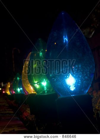 Row of oversized outdoor Christmas lights