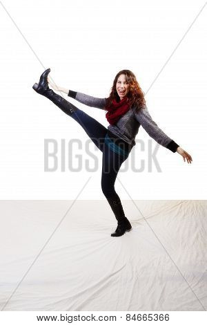 Young Caucasian Woman Kicking Jeans Boots Sweater Scarf