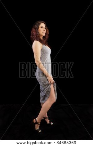 Caucasian Woman Standing Grey Dress Holding Up Hem