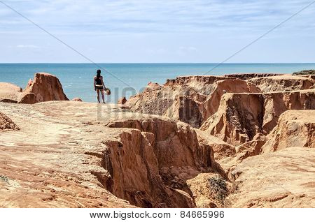Young Woman On The Cliffs Of The Beach