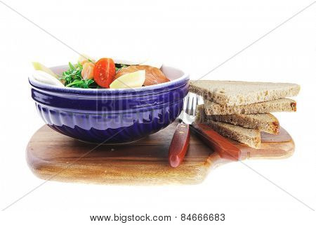 fresh green salad with smoked salmon on wood