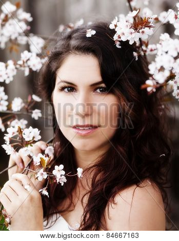 Caucasian Woman Portrait Among White Blossoms Outdoors
