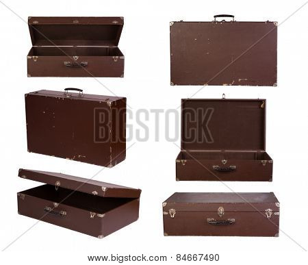 Old suitcases isolated on white background