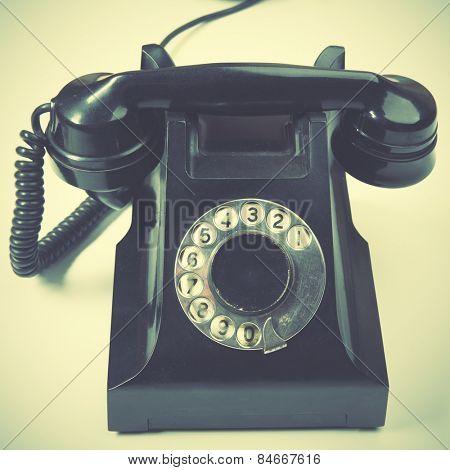 Vintage telephone. Retro style filtred image
