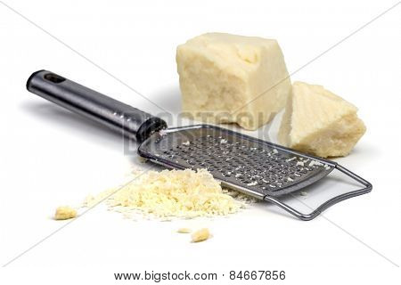 parmesan with grater on wood table