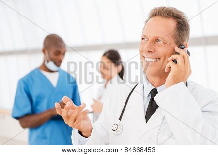 Cheerful Doctor On The Phone.