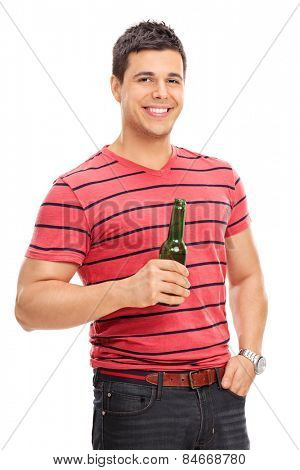 Casual young guy drinking beer isolated on white background