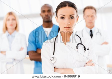 Confident Doctor Leading Her Team.