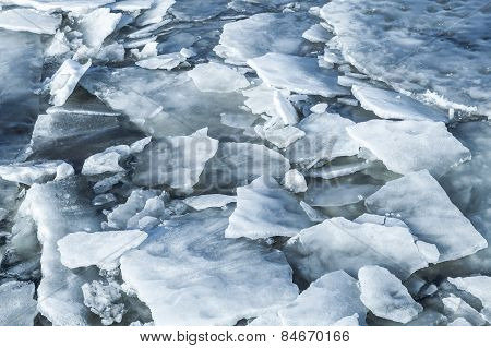 Big Ice Fragments Covered With Show On Frozen River Water