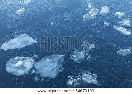 Ice Fragments Under Thin Layer Of Frozen River Water