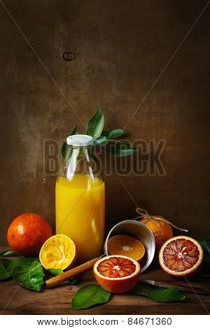 Still Life With Orange Fruit And Juice