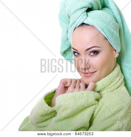beautiful model with healthy skin face in bathrobe and towel, over white background