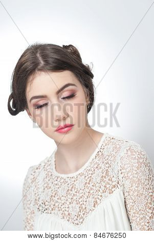 Hairstyle and make up - beautiful young girl art portrait with closed eyes. Genuine natural brunette