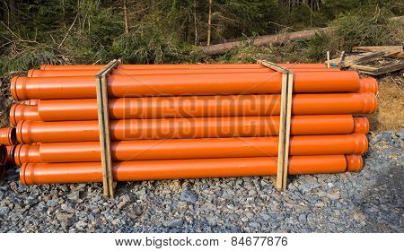 Orange Pipes Stored On A Construction Site