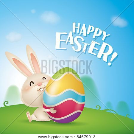 Happy Easter! Easter bunnies and egg in field. Wide copy space for text.