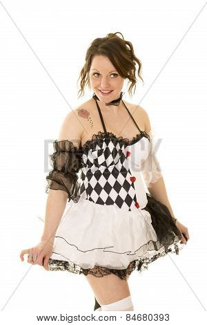 Woman In A Black And White Costume Holding Out Skirt