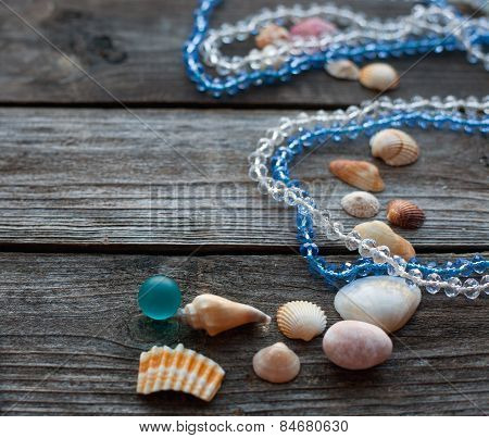 Seashells And Pebbles On The Wooden Table Soft Focus