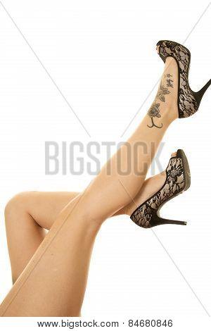 Woman Legs Tattoo On Foot Kicked Up