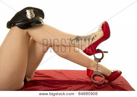 Woman Legs With Cop Hat On Knee Red Heels And Tattoo