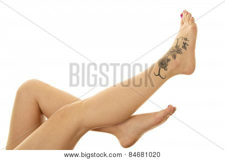 Woman Legs With Tattoo On Foot Up