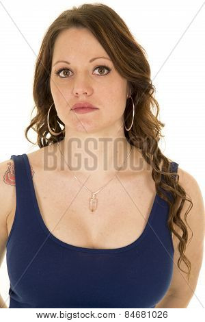 Woman Up Close In Blue Tank Top Looking With Rose Tattoo