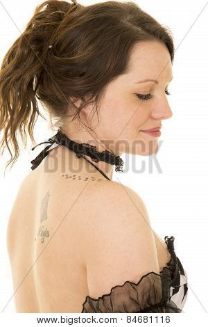 Woman With Hair Up From Side Eyes Down Bare Shoulder
