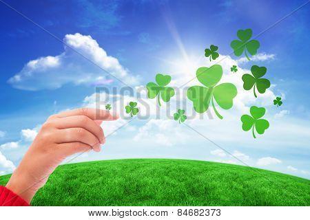 Shamrock against green hill under blue sky