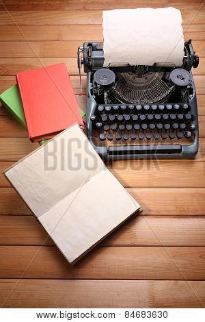 Antique Typewriter. Vintage Typewriter Machine on wooden table