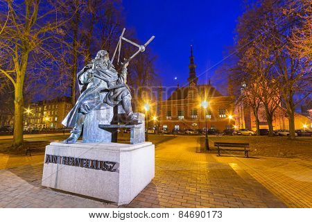 Monument of astronomer Johannes Hevelius with historical architecture of Gdansk, Poland