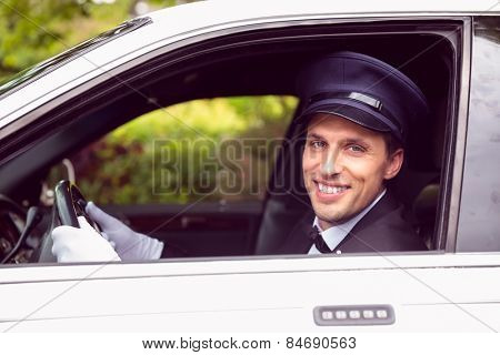Limousine driver smiling at camera on a sunny day