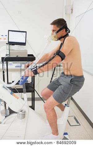 Man doing fitness test on exercise bike at the medical centre