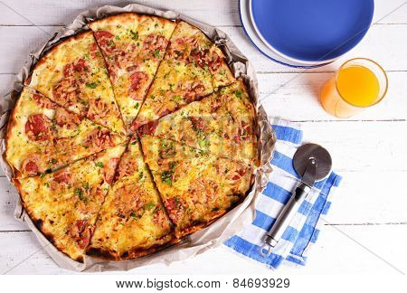 Tasty pizza with tableware on wooden table close up