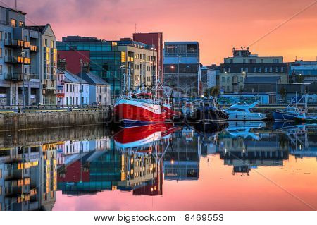 Morning View On Row Of Buildings And Fishing Boats In Docks, Hdr Image