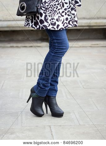Girl's Leg With Black Boots