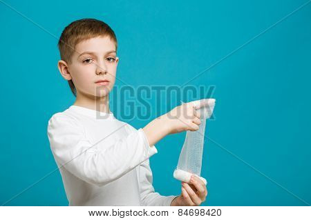 Unhappy Boy Taping Up Bandage On His Finger