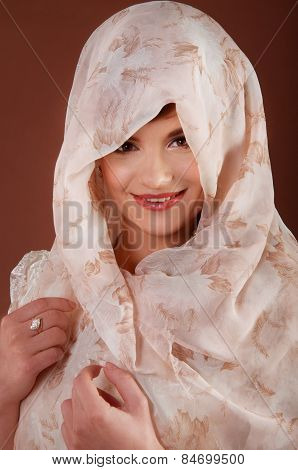 Beautiful Young Woman In Headscarf. Muslim Tradition.