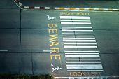 foto of zebra crossing  - zebra crossing on urban asphalt road for passenger or people and transportation at night time top view - JPG
