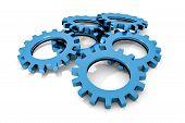 stock photo of cogwheel  - stack of blue colored metallic cogwheels on white surface illustration - JPG