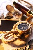 stock photo of spyglass  - Marine still life spyglass and world map on old wooden background - JPG