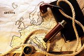 stock photo of spyglass  - Marine still life spyglass and world map on wooden background - JPG